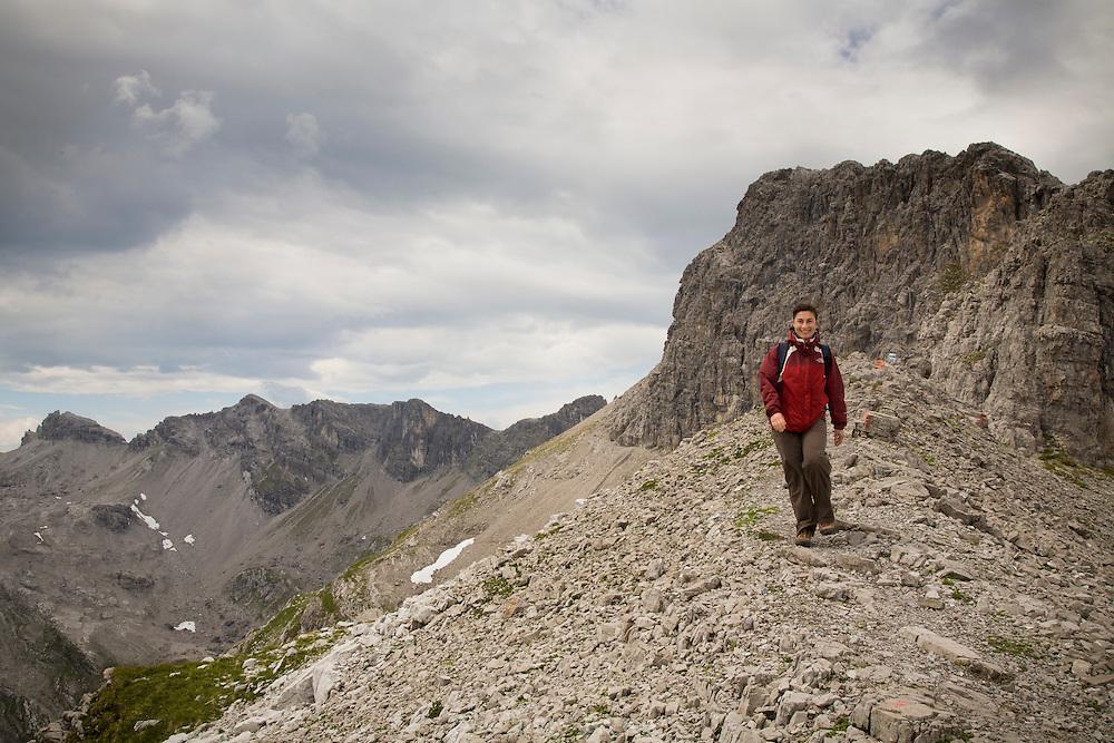 Hiker following a high ridgeline in the west Austrian Alps