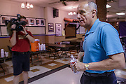 02 AUGUST 2012 - PHOENIX, AZ:   Dr. RICHARD CARMONA walks into a veterans' town hall meeting during a campaign stop at an American Legion Hall in Phoenix Thursday. Carmona, the former US Surgeon General under President George W. Bush, is running for the US Senate as a Democrat. Carmona's personal story is an important part of his campaign. He dropped out of high school to join the US Army. He applied for Special Forces and was turned down because he didn't have a high school diploma, he got his GED, reapplied and was accepted into Special Forces. He served in Vietnam as a combat medic. After he was discharged, he went back to college, became a R.N., went to medical school and became a surgeon, became a police officer and member of the SWAT Team in Tucson, AZ. He became the surgeon general in 2002 and returned to Tucson after his term as surgeon general.     PHOTO BY JACK KURTZ