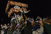 A Japanese woman rides on a mikoshi during the summer festival or matsuri in Matsuda, Kanagawa, Japan. Saturday August 22nd 2015