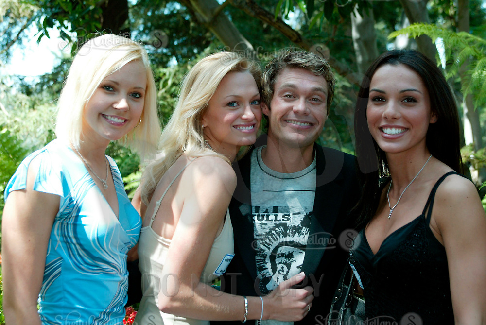 Apr 24, 2003; Holmby Hills, CA, USA; 'American Idol' host RYAN SEACREST @ 2003 Playboy Playmate of the Year party held @ the Playboy Mansion.  Pictured here with former playmates (L-R) STACY FUSON, LAURIE FETTER & CARMELLA DECESARE.<br />Mandatory Credit: Photo by Shelly Castellano/ZUMA Press.<br />(©) Copyright 2003 by Shelly Castellano