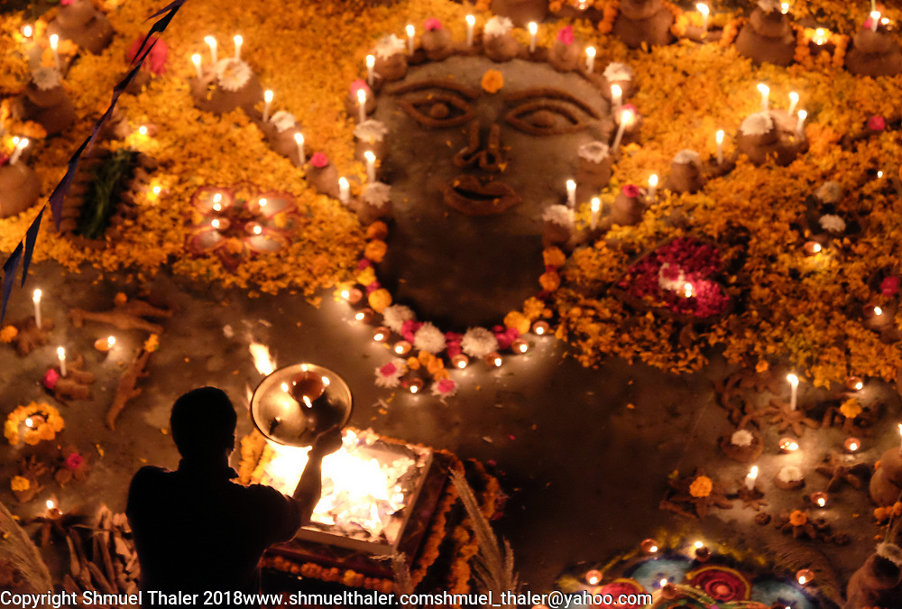 An decorated altar made of cow dung and lit with candles at Sri Ram Ashram on the holiday of Govardhan honoring cows.<br /> Photo by Shmuel Thaler <br /> shmuel_thaler@yahoo.com www.shmuelthaler.com