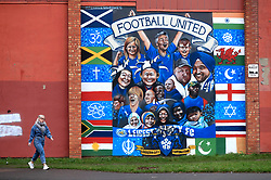 """A general view of a pedestrian walking past a Leicester City mural prior to the Premier League match at the King Power Stadium, Leicester. PRESS ASSOCIATION Photo. Picture date: Saturday January 12, 2019. See PA story SOCCER Leicester. Photo credit should read: Mike Egerton/PA Wire. RESTRICTIONS: EDITORIAL USE ONLY No use with unauthorised audio, video, data, fixture lists, club/league logos or """"live"""" services. Online in-match use limited to 120 images, no video emulation. No use in betting, games or single club/league/player publications."""