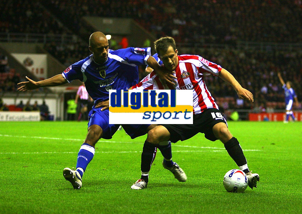 Photo: Andrew Unwin.<br /> Sunderland v Cardiff City. Coca Cola Championship. 31/10/2006.<br /> Sunderland's Tobias Hysen (R) looks to hold off Cardiff's James Chambers (L).