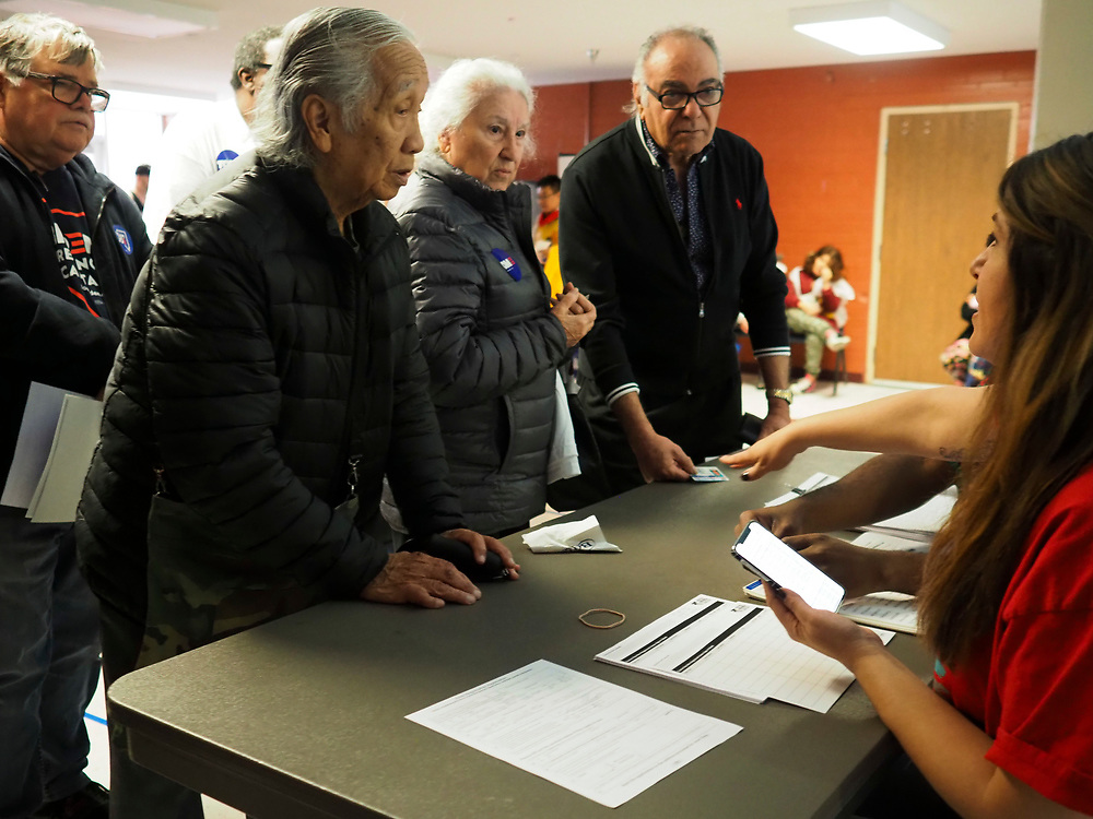 Registration begins for a caucus at Valley High School in Las Vegas, Nevada