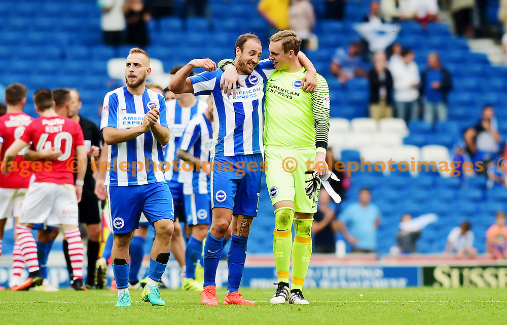 Two goal scorer Glenn Murray of Brighton celebrates the win with goalkeeper David Stockdale during the Sky Bet Championship match between Brighton and Hove Albion and Barnsley at the American Express Community Stadium in Brighton and Hove. September 24, 2016.<br /> Simon  Dack / Telephoto Images<br /> +44 7967 642437