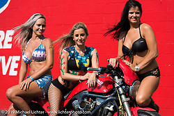 Jenny Giddens, Harli Ingwersen and Linda Everett at the drag strip Saturday afternoon during the Smokeout. Rockingham, NC. USA. June 20, 2015.  Photography ©2015 Michael Lichter.