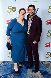 Naga Munchetty and Paul Sinha attending the TRIC Awards 2019 50th Birthday Celebration held at the Grosvenor House Hotel, London.
