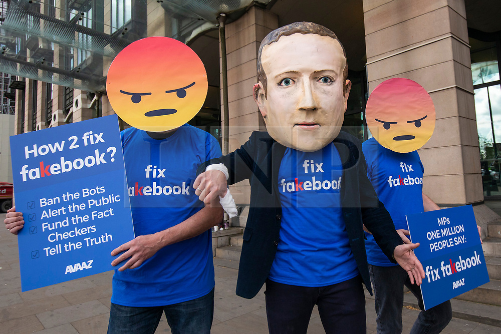 © Licensed to London News Pictures. 26/04/2018. London, UK. Campaigners from Avaaz with a giant Mark Zuckerberg head protest outside Portcullis House to call on MPs to 'fix facebook'. Facebook's CTO Mike Schroepfer is appearing before a Select Committee. Photo credit: Rob Pinney/LNP