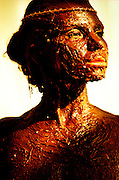 Woman covered in chocolate icing