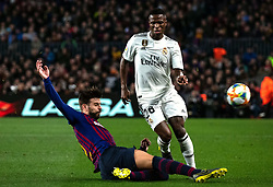 BARCELONA, Feb. 7, 2019  Real Madrid's Vinicius Junior (R) competes with FC Barcelona's Gerard Pique during the Spanish King's Cup semifinal first leg match between FC Barcelona and Real Madrid in Barcelona, Spain, on Feb. 6, 2019. The match ended with a 1-1 draw. (Credit Image: © Joan Gosa/Xinhua via ZUMA Wire)