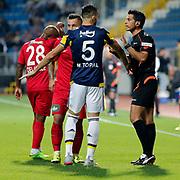 Kasimpasa's Yonathan Del Valle (L) and Fenerbahce's Mehmet Topal (C)  during their Turkish Superleague soccer match Kasimpasa between Fenerbahce at the Recep Tayyip Erdogan stadium in Istanbul Turkey on Sunday 13 September 2015. Photo by Aykut AKICI/TURKPIX