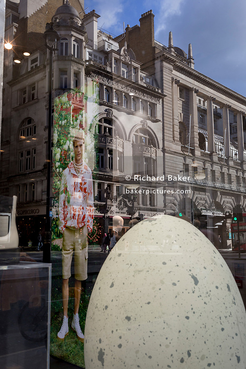 The image of a male model stands in the window display of clothing retailer, Tiger of Sweden, the Stockholm-based fashion house established in 1903 with a heritage in tailoring, on 11th February 2020, in London, England.