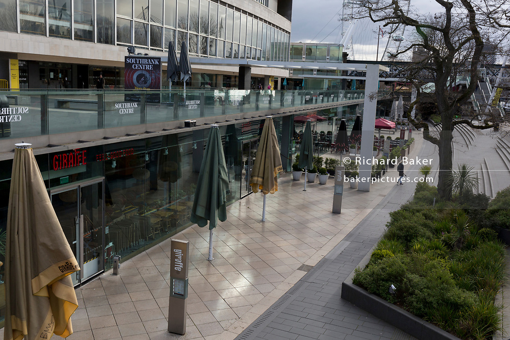 As the UK government announces further Coronavirus-related restrictions to its citizens, with the immediate closure of pubs, cafes, gyms and cinemas, and the worldwide number of deaths reaching 10,000 with 240,000 cases, 953 of those in London alone, the capital's Southbank remains largely deserted, on 20th March 2020, in London, England.