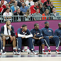 31 July 2012: USA Kobe Bryant, Tyson Chandler, Anthony Davis, Chris Paul, LeBron James and Kevin Durant sit on the bench during 110-63 Team USA victory over Team Tunisia, during the men's basketball preliminary, at the Basketball Arena, in London, Great Britain.