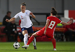 England Women's Lucy Bronze (left) and Wales Women's Angharad James battle for the ball