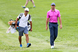 August 3, 2018 - Akron, Ohio, United States - Rory McIlroy (R) and his caddie approach the first tee during the second round of the WGC-Bridgestone Invitational at Firestone Country Club. (Credit Image: © Debby Wong via ZUMA Wire)
