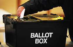 File photo dated 06/05/10 of a voter placing a ballot paper in the ballot box at a polling station, as new figures show the Conservatives could win a majority of more than 100 seats in the General Election if the difference in turnout between young and old voters mirrors the 2015 contest.
