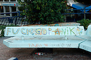 Israel, Tel Aviv, Graffiti on the benches - Dizengoff circle in centre Tel Aviv. Main meeting place for local punks. October 2005