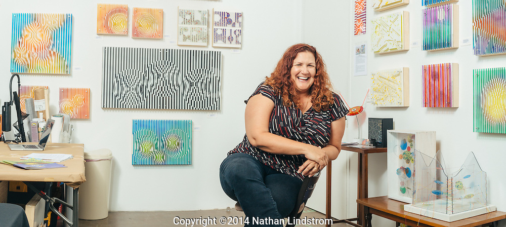 Lorena Morales, Venezuelan painter, photographed at her Houston, TX studio.<br /> Photographed by editorial photographer Nathan Lindstrom.