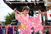 A young dancer on the central stage moves in sync to the music during Sunday's 63rd annual Obon Festival at the Buddhist Temple of Salinas.