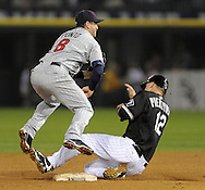 CHICAGO - SEPTEMBER 23:  Nick Punto #8 of the Minnesota Twins turns a double play over a sliding A.J. Pierzynski #12 of the Chicago White Sox on September 23, 2009 at U.S. Cellular Field in Chicago, Illinois.  (Photo by Ron Vesely)