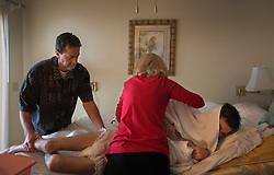 Judy and Wayne Cox care for their son, Chris, 29, a traumatic brain injury survivor, Destin, Fla., Nov. 20, 2011. Cox was left with debilitating back pain after an A.T.V. accident. He underwent physical therapy to no avail and accidentally overdosed on Oxycontin, leaving him clinically deceased for 15 to 30 minutes. He was revived but suffered severe lack of oxygen to his brain and was diagnosed as minimally conscious. Cox's family entered him into a clinical trial, testing medicines that evoked Òparadoxical excitation,Ó such as Ambien, and have witnessed a heightened sense of awareness in their son.