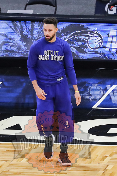 ORLANDO, FL - FEBRUARY 19:  Stephen Curry #30 of the Golden State Warriors warms up against the Orlando Magic  at Amway Center on February 19, 2021 in Orlando, Florida. NOTE TO USER: User expressly acknowledges and agrees that, by downloading and or using this photograph, User is consenting to the terms and conditions of the Getty Images License Agreement. (Photo by Alex Menendez/Getty Images)*** Local Caption *** Stephen Curry