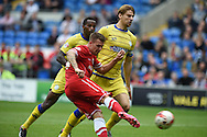 Anthony Pilkington of Cardiff city © shoots and scores his sides 2nd goal. Skybet football league championship match, Cardiff city v Sheffield Wed at the Cardiff city stadium in Cardiff, South Wales on Saturday 27th Sept 2014<br /> pic by Andrew Orchard, Andrew Orchard sports photography.