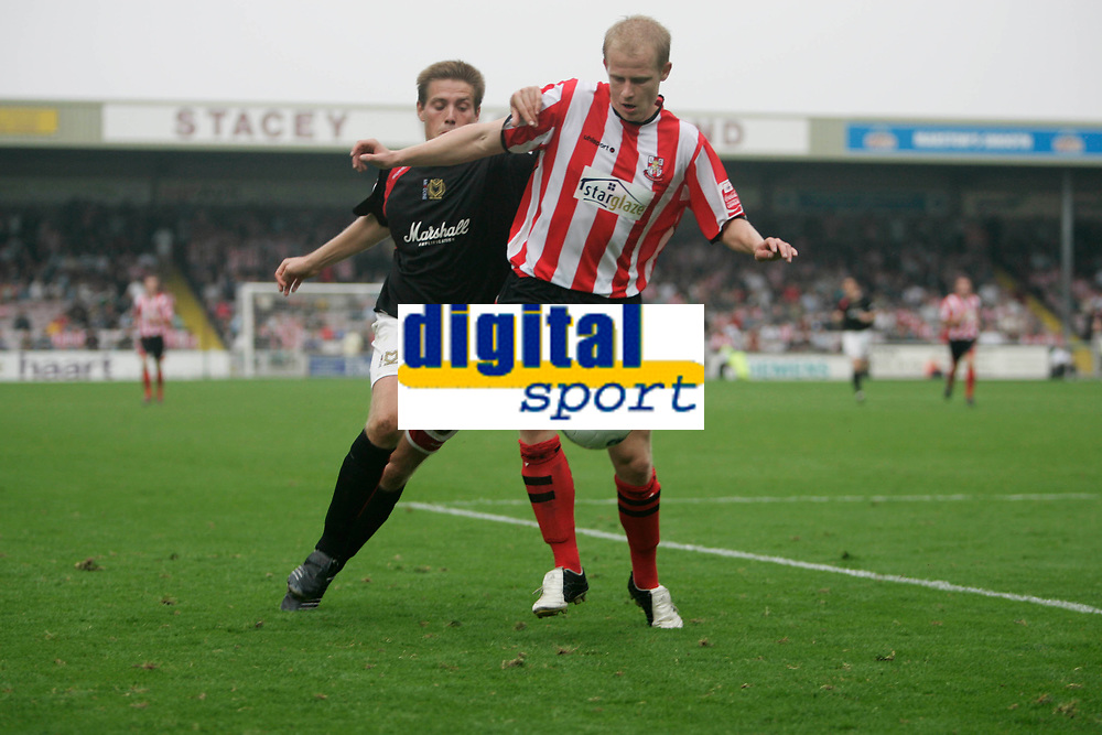 Photo: Pete Lorence.<br />Lincoln City v Milton Keynes Dons. Coca Cola League 2. 16/09/2006.<br />Gareth Edds chases down Paul Mayo of Lincoln City.