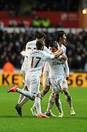 Swansea city's Pablo Hernandez © celebrates with Itay Shechter (17), Ben Davies (33) and Ki Sung-Yueng ® after he scores his sides equalising goal to make it 1-1. Barclays Premier league, Swansea city v Chelsea at the Liberty Stadium in Swansea, Swansea, South Wales on Saturday 3rd November 2012. pic by Andrew Orchard, Andrew Orchard sports photography,