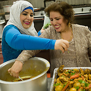 Lailoma Dost (right) age 50 seen with her sister Anisa Sofizada (left) preparing food at a banquet hall for Lailoma's grandson Farhan's first birthday party. For a follow up story on the Dost family. A family of Afghans who escaped the war in Afghanistan in the 1990's, escaped to Pakistan and immigrated to Canada in 2004 as refugees and now live in Winnipeg, Manitoba. (Credit Image: © Louie Palu/ZUMA Press)
