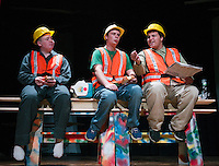 """Three construction workers """"Charlie"""" Shawn Zappala, """"Frank"""" Michael VonGeorge and """"Joe"""" Quincy Morris take their lunch hour on the girder during dress rehearsal for """"Mere Mortals"""" at Laconia High School Monday afternoon.  (Karen Bobotas/for the Laconia Daily Sun)"""