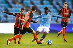 Manchester City U19's Tom Dele-Bashiru battles for the ball with Shakhtar Donetsk's Maksym Chekh (left) and Nazarii Muravskyi