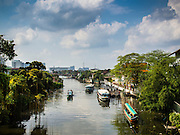15 FEBRUARY 2015 - BANGKOK, THAILAND: Boats on Khlong Bangkok Yai, one of the larger khlongs (canals) in the Thonburi section of Bangkok. Khlong Bangkok Yai runs close to the north edge of the Kudeejeen neighborhood.       PHOTO BY JACK KURTZ