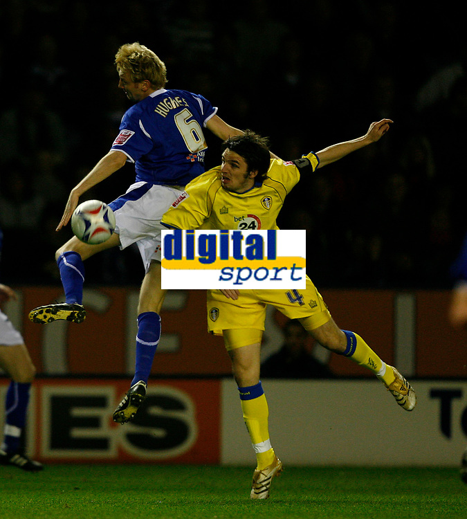 Photo: Steve Bond.<br />Leicester City v Leeds United. Coca Cola Championship. 13/03/2007. Jonathan Douglas (right) contests an aerial ball with Stephen Hughes (left)
