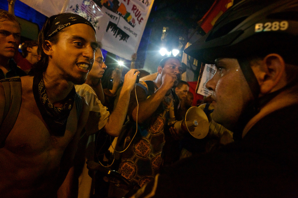 Protester William Estrella, left, talks to police as law enforcement officers form a line around protesters during the 2012 Democratic National Convention on Thursday, September 6, 2012 in Charlotte, NC.
