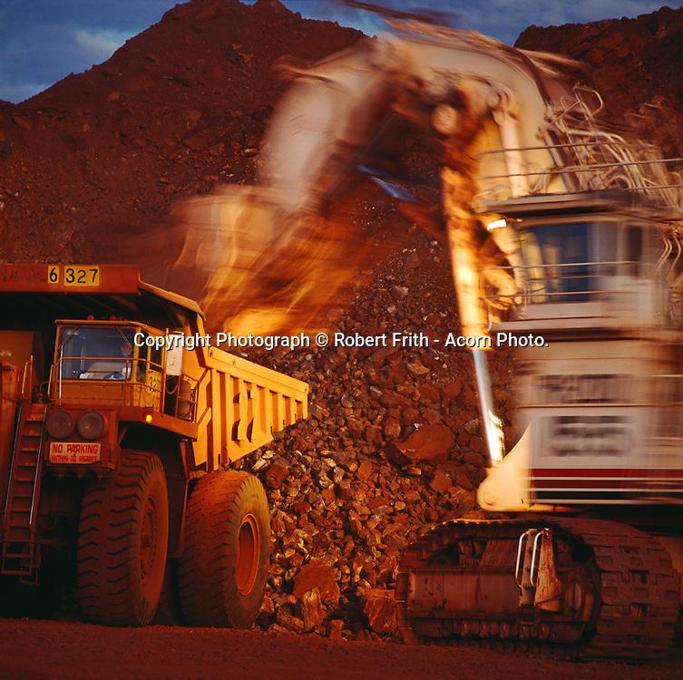 Haulpak and excavator at Mount Tom Price iron ore mine site