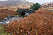 Stone bridge over Coladoir River on Glen More, Isle of Mull, Scotland.