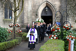 Chesterfield goalkeeper Joe Anyon (left) and Leicester City goalkeeper Kasper Schmeichel carry the coffin during the funeral service for Gordon Banks at Stoke Minster.
