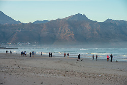 People out excercising early Friday morning, at Strand, Western Cape, May 1st, 2020, the first day allowed to do so after lockdown 35 days ago. From today, South Africa moves to Level 4, from Level 5 lockdown. People are also mandated to wear masks in public at all times. PHOTO: EVA-LOTTA JANSSON