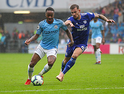 September 22, 2018 - Cardiff City, England, United Kingdom - Raheem Sterling of Manchester City and Joe Ralls of Cardiff City battle for possession during the Premier League match between Cardiff City and Manchester City at Cardiff City Stadium,  Cardiff, England on 22 Sept 2018. (Credit Image: © Action Foto Sport/NurPhoto/ZUMA Press)