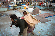 A homeless woman attacks a homeless man during an argument in an area full of the homeless, destitute and poor near the Jama Masjid. Delhi, India<br /> It is estimated that around than 150000 people - more than one percent of the city - is homeless and, with constant migration this is increasing on a daily basis. The incidence of mental illness amongst this group is very high. Delhi has little formal provision to deal with such a situation