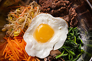 23 Augst 2019 -- OVERLAND, Mo. -- At Sides of Seoul restaurant in Overland the BiBim Bop, a Korean rice bowl, features beef bulgogi, carrot, mushroom, soybean sprouts, spinach and fried egg with Rice and Korean spicy pepper paste. Photographed at the restaurant Friday, Aug. 23, 2019. Photo © copyright 2019 Sid Hastings.