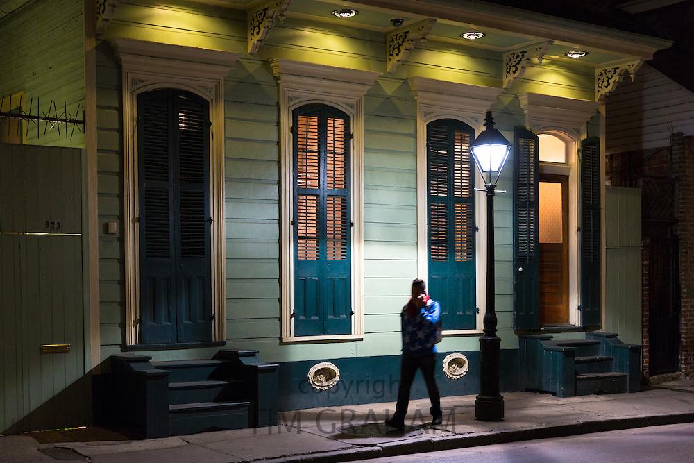 Man walks in residential neighbourhood on Bourbon Street in French Quarter of New Orleans, Louisiana, USA