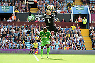 Aston Villa goalkeeper Brad Guzan saves from Sunderland's Jermain Defoe. Barclays Premier League match, Aston Villa v Sunderland at Villa Park in Birmingham, Midlands on Saturday 29th August  2015.<br /> pic by Andrew Orchard, Andrew Orchard sports photography.