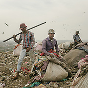 Raju, a cloth recycler in Bhalswa, on top of one of the giant open air garbage dump which burns 24/7, creating toxic fumes.