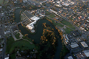 """The Napa River forms an oxbow in downtown Napa, as seen in this March 13, 2004 aerial photo. The bends in the river present flooding problems in heavy rains. Napa's unique """"Living River"""" flood control project allows water to flow in its historical channel, creating wetlands, restoring the life of the river, and protecting property from floods."""