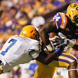 October 16, 2010; Baton Rouge, LA, USA; LSU Tigers running back Stevan Ridley (34) breaks the tackle by McNeese State Cowboys safety Brandon Robinson (7) on a touchdown run during the first half at Tiger Stadium.  Mandatory Credit: Derick E. Hingle