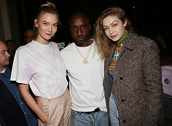 "Karlie Kloss, Virgil Abloh and Gigi Hadid attends the launch of Evian and Virgil Abloh's limited-edition ""One Drop can make a Rainbow"" collection at Théâtre National de Chaillot in Paris, France on February 25, 2019. Photo by Jerome Domine/ABACAPRESS.COM"