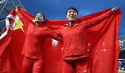 China's Lingwei Li celebrates winning Silver with Huihui Lyu who won Bronze in the Women's Javelin during day five of the 2017 IAAF World Championships at the London Stadium.